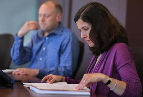 Managing principal Rebecca Kirk Fair and vice president Aaron Yeater review a case.